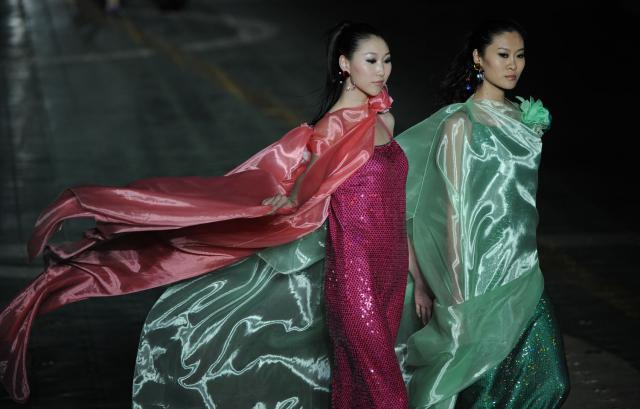 2011. Pierre Cardin Haute Couture Creation Fashion show on an aircraft carrier in Tianjin -